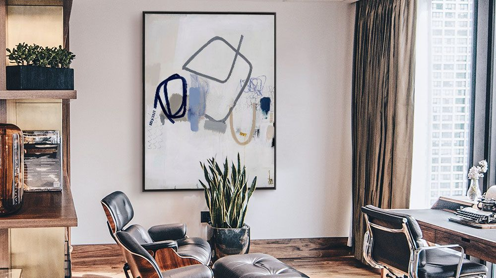 Contemporary abstract art print featuring minimal linework hung in a modern office with Eames Lounger chairs