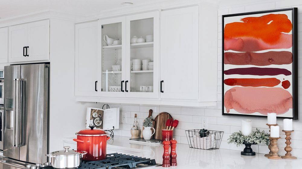 Red abstract watercolor framed canvas print in a contemporary kitchen.