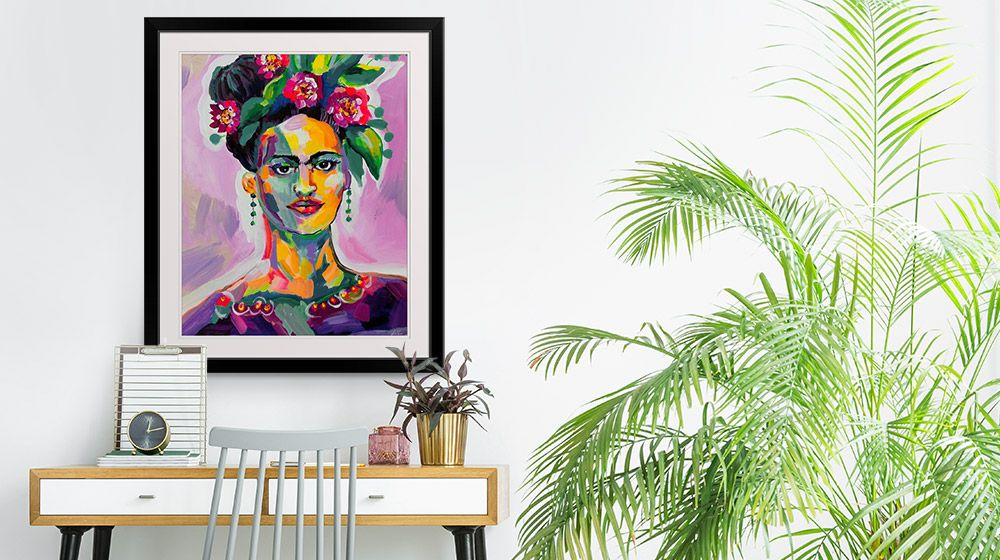 Motivational feminine framed print in a bohemian home office interior