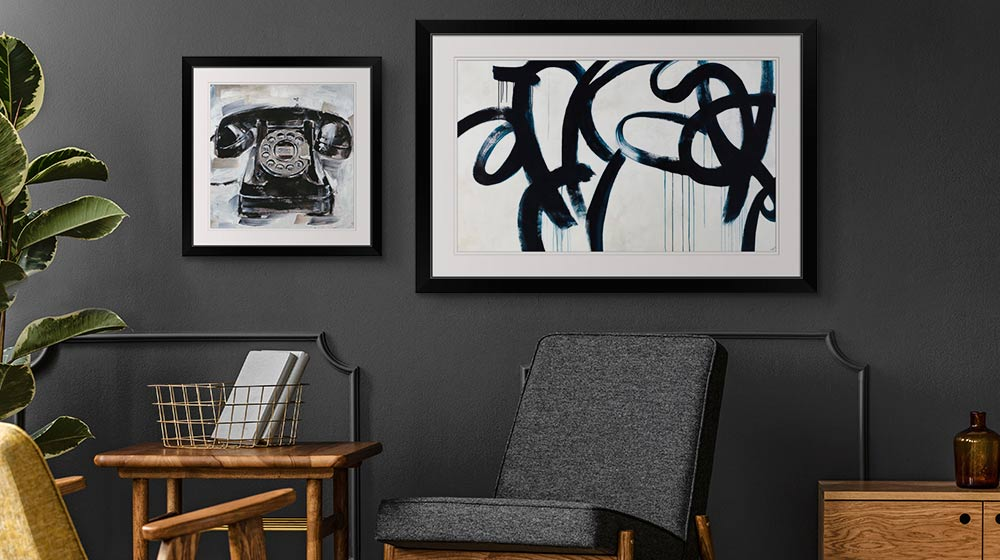 Modern framed art prints in a dark modern office space