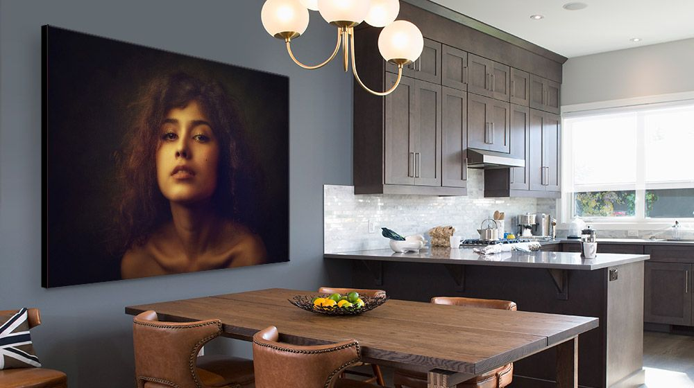 Large photographic portrait of a woman canvas print in modern Dining Room/Kitchen interior.