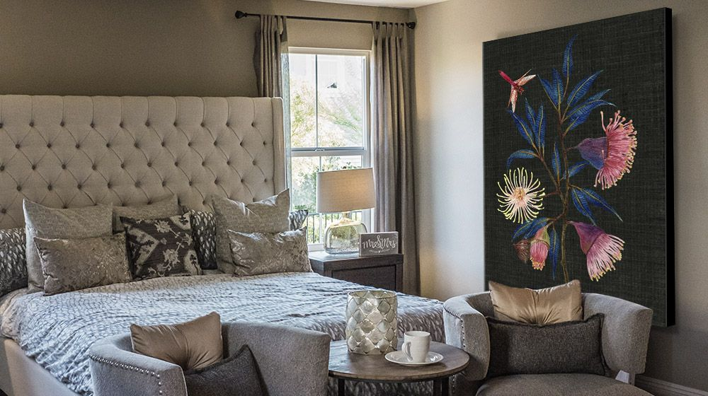 Large floral canvas art print in a stylish neutral bedroom interior