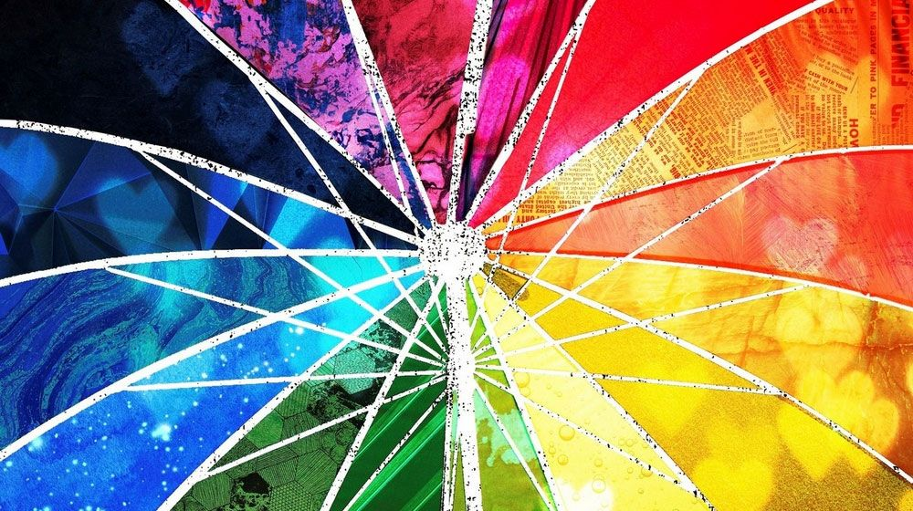 Detailed close up image of rainbow collage umbrella artwork.
