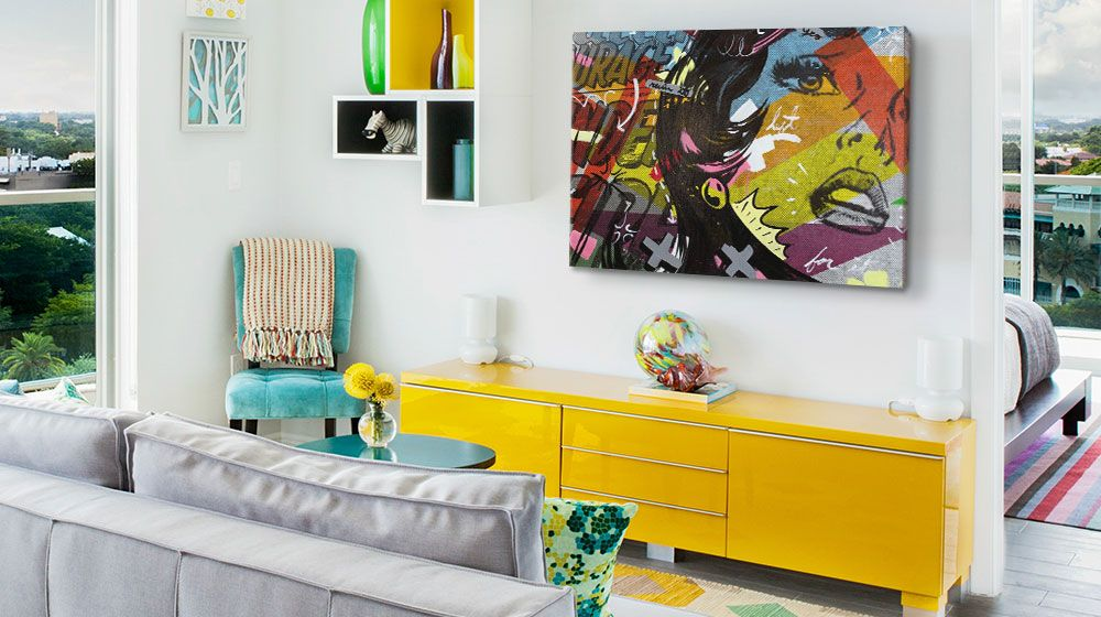 Colorful pop art comic inspired canvas print in a vibrant living room with contemporary furniture.
