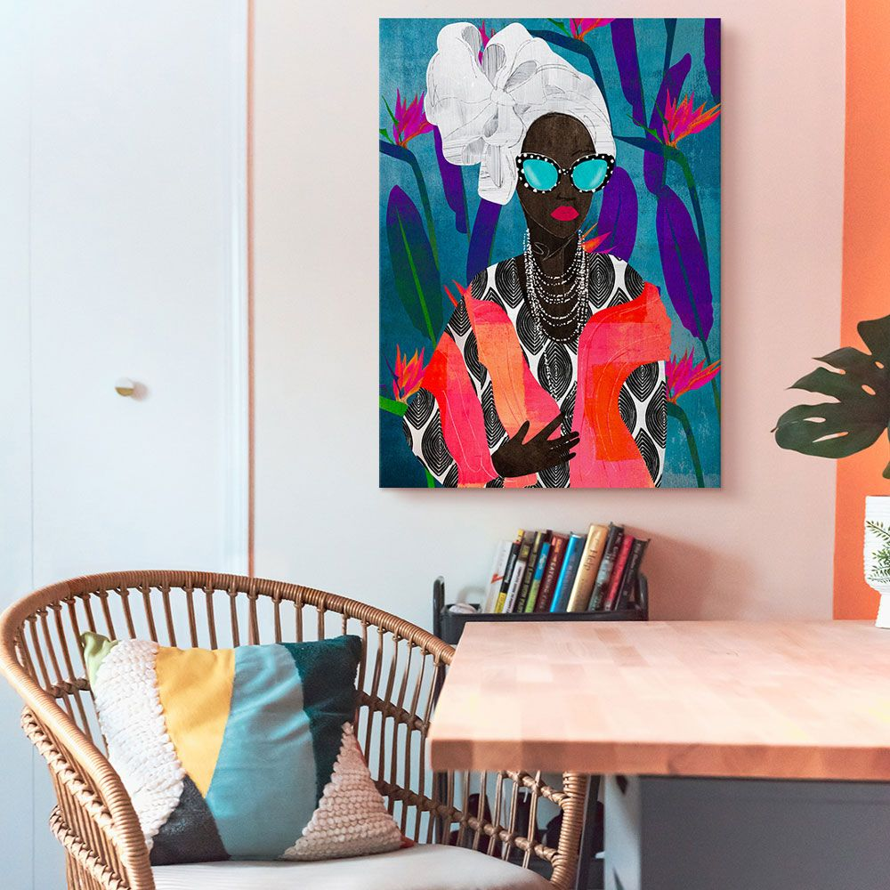 Brightly colored wall art hung on a wall of a bohemian-styled space
