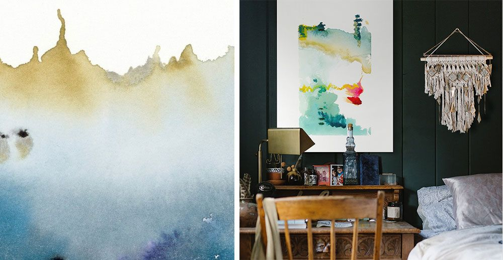 Watercolor abstract canvas print on the wall of a dark bedroom interior.