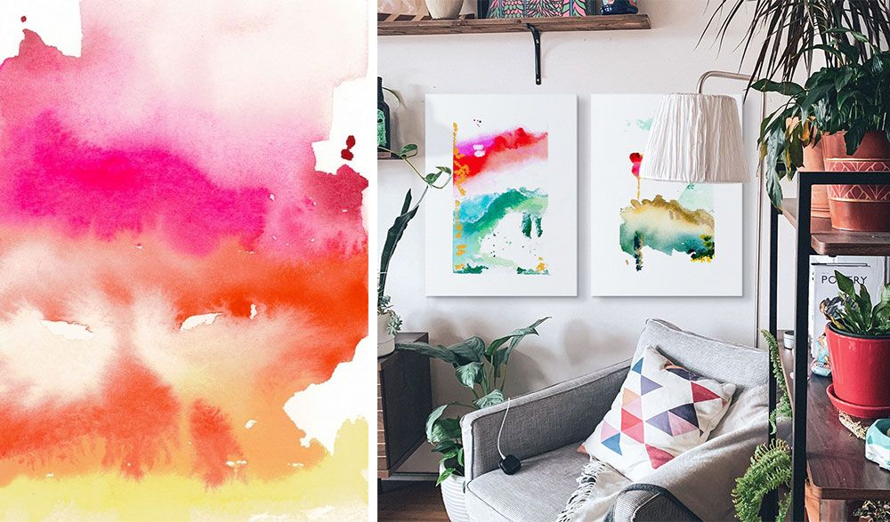 A Room interior of a living room with two canvas prints of watercolor abstract work hanging on wall.