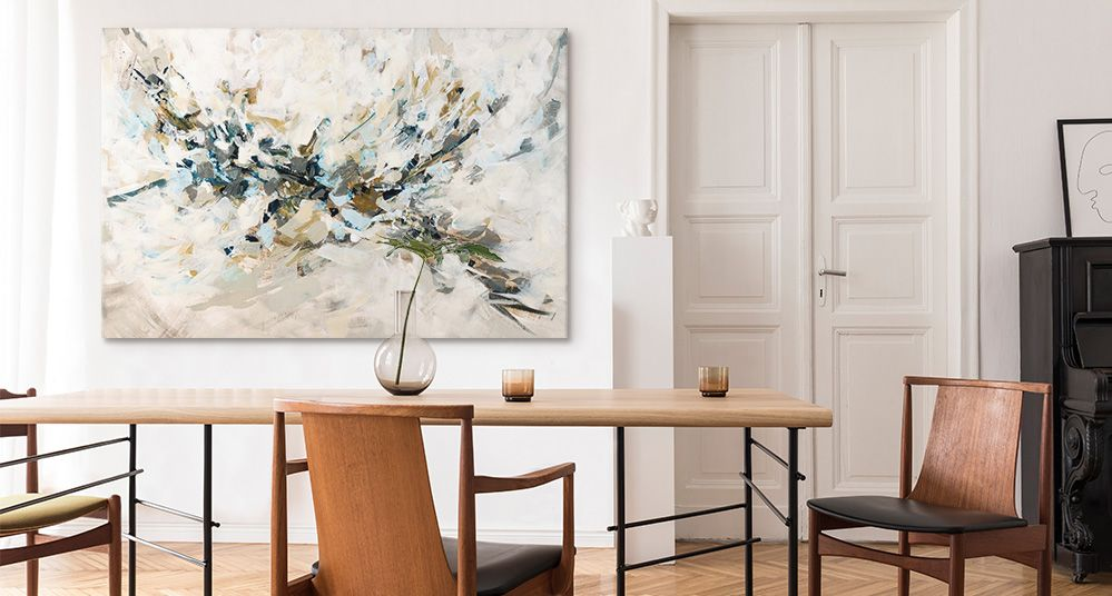 A large neutral abstract canvas print in a modern dining room.